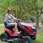 Tara mowing lawns at Mum and Dad's